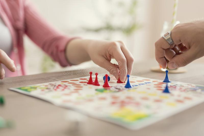 Detail of playing the ludo board game royalty free stock photo