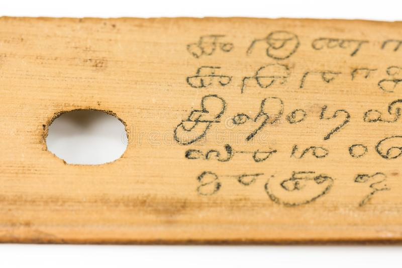 Detail of a preserved palm leaf manuscript royalty free stock photography