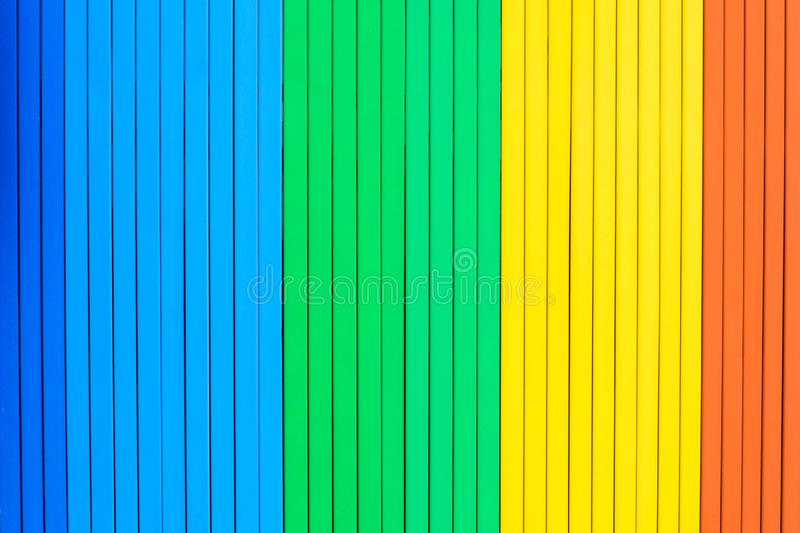 Detail of a rainbow colored wooden. stock photography
