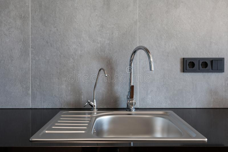 Download Detail Of A Rectangular Designer Kitchen Sink With Chrome Water Tap Stock Photo