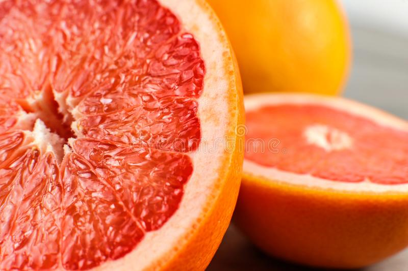 Detail of red grapefruit cut in half. royalty free stock images