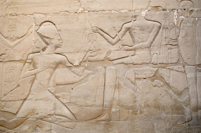 Detail of relief in the Precinct of Amun-Re (Karnak Temple Complex, Luxor, Egypt). Detail of relief on the wall in the Precinct of Amun-Re (Karnak Temple Complex stock photography