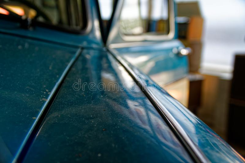 Detail of retro car window and body part, selective focus stock images