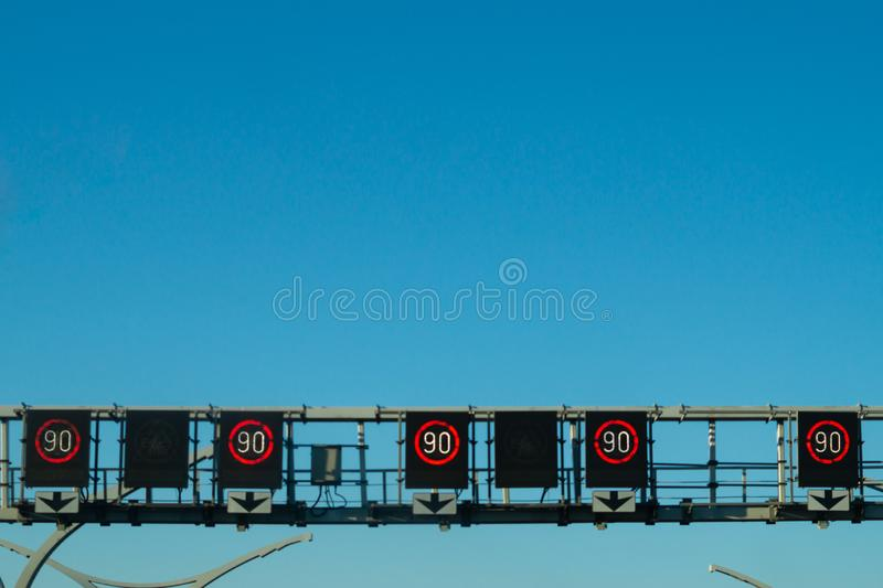Detail of the roadway. view of the speed limit on the electronic board stock photo