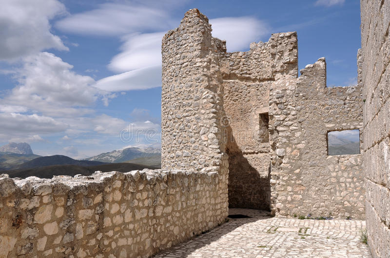 Detail of rocca calascio fortress, abruzzi. Ruins of ancient fortification in barren landscape of apennines high mountains royalty free stock photo