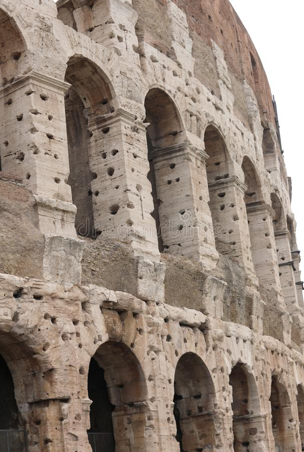 Detail of the Roman Colosseum in Italy in Rome with arches and m. Detail of the Roman Colosseum in Italy in Rome with arches and holes on the wall to recover the stock photo