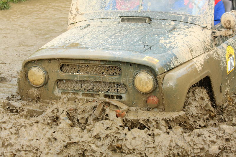 Detail of a russian offroad car UAZ. UAZ, russian military offroad car going through a deep puddle of mud during an offroad race in Trstenice, Czech Republic, in stock images