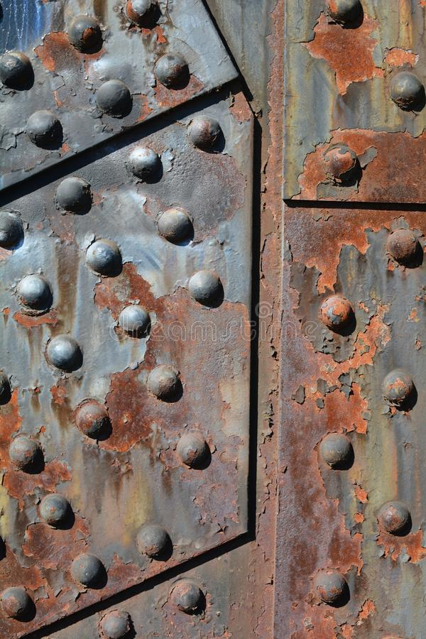 Rusting steel plates on Steel Bridge in Portland, Oregon. This is a detail of rusting steel plates and rivets on Steel Bridge in Portland, Oregon. It spans the stock photography