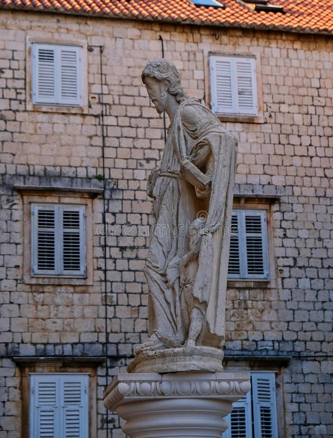 Saint Thomas Statue in Trogir Town Square, Croatia. Detail of a Saint Thomas, a male stone statue in Trogir Town Square, Croatia, Dalmatia stock photos