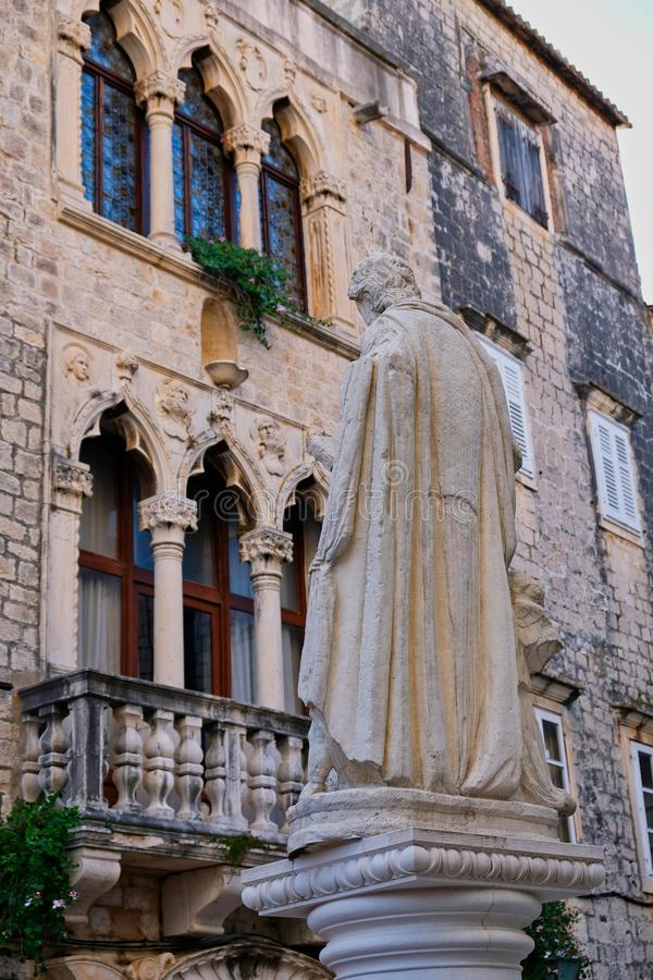 Saint Thomas Statue And Historic Cipiko Palace, Trogir, Croatian stock photo