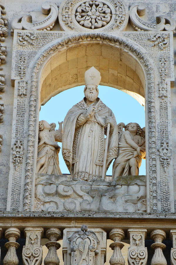 Detail of Sant`Oronzo statue on Lecce Cathedral, Apulia, Italy.  stock photography