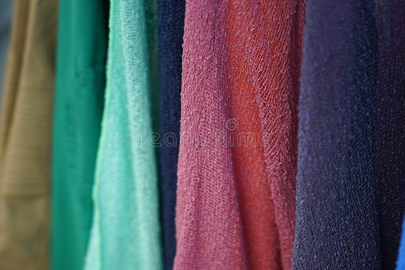 Detail of scarves and scarves of various colors in a shop in Parikia, Paros. Greece neck wind cotton craft feminine beautiful scarf background summer wearing stock images