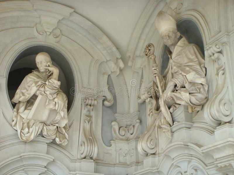 Detail of sculpture of ecclesiastical men in ornament wall ot he Chartreuse of St. Martin in Naples, Italy. Detail of sculpture of ecclesiastical men in stock images