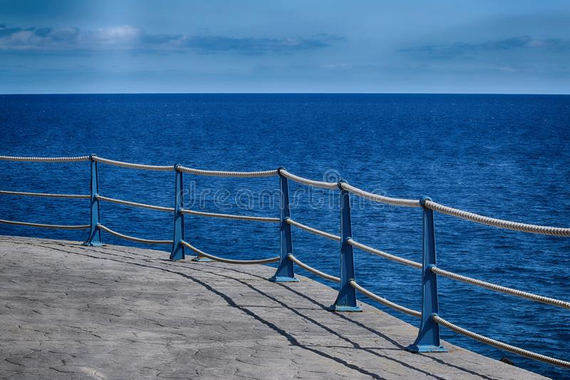 Detail of Sea Wall Roped Barrier. Detail of Sea Wall safetyn Rope effect Barrier royalty free stock photo