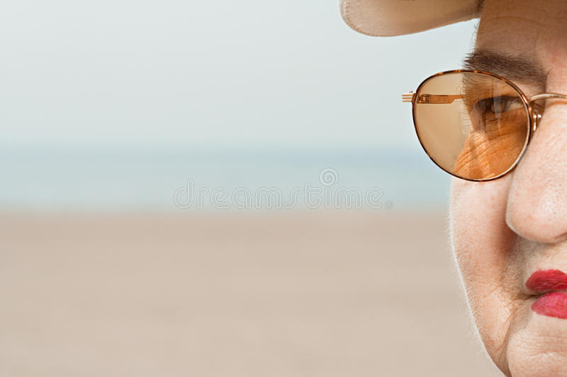 Detail of senior woman wearing glasses royalty free stock images