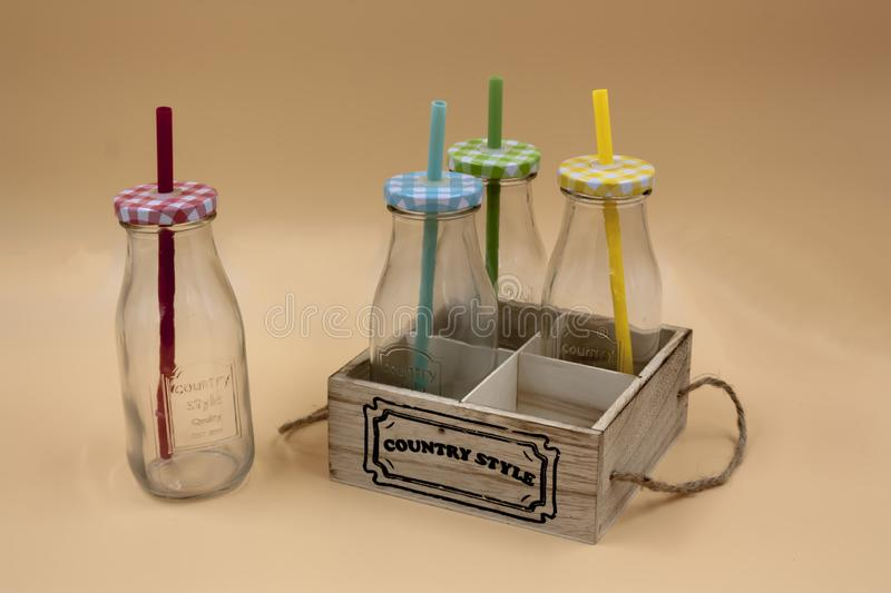 Detail of set of glass bottles with lid and straws of various colors stock photos