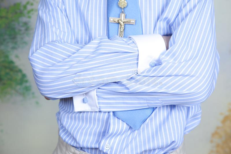 Detail of the shirt with stripes in blue and white and blue sky tie stock images