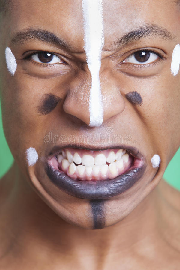 Download Detail Shot Of Aggressive Mixed Race Man With Painted Face Clenching Teeth Stock Image - Image: 30856041