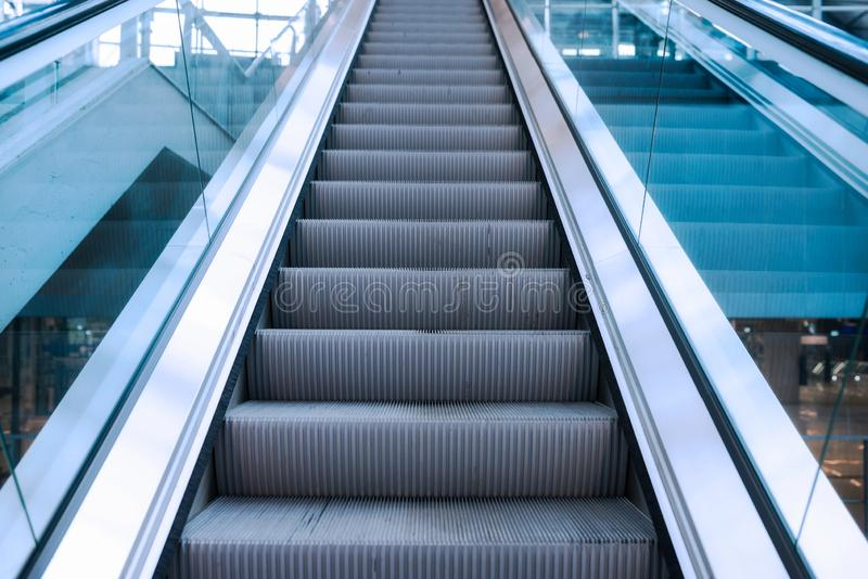 Detail shot of escalator in modern buildings. Or subway station metal architecture perspective up urban transport move staircase mall interior public business stock photos