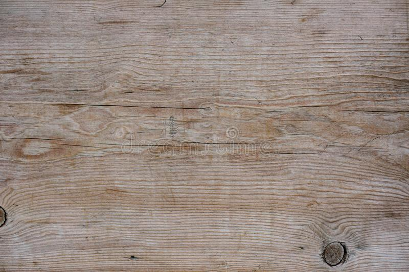 Old wooden board texture. Detail shot of an old wooden board texture. Visible grain royalty free stock photography