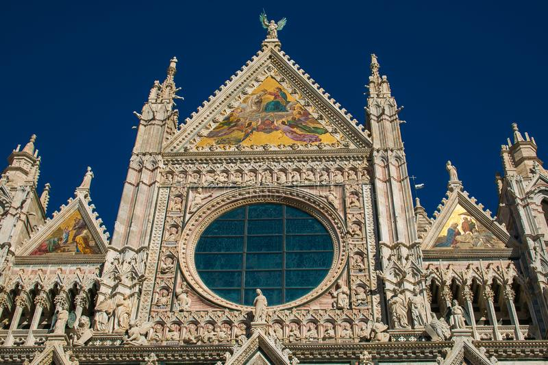 Detail of Siena cathedral against the blue sky royalty free stock photo