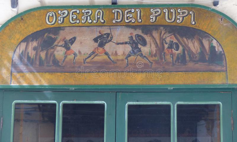 Detail of the sign of the theater of the opera of the Pupis to Palermo, Sicily, Italy. royalty free stock image