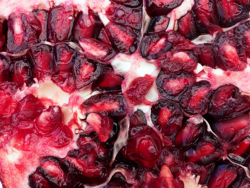 Detail of a Sliced Ripe Pomegranate royalty free stock images