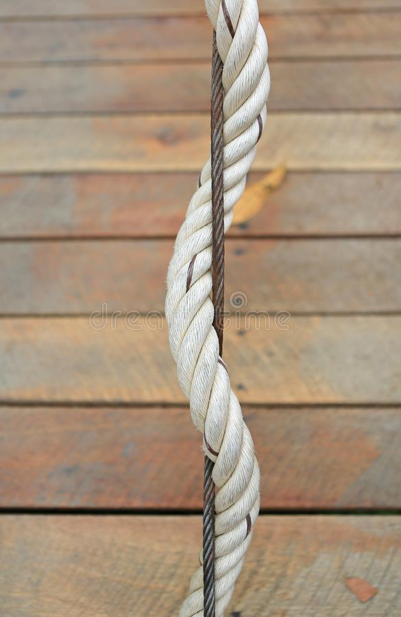 Detail of sling and rope for safety on the wood bridge stock image