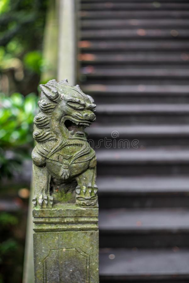 Detail of a small chinese lion sculpture on a stone bridge in a park in Wenzhou in China - 2 royalty free stock images