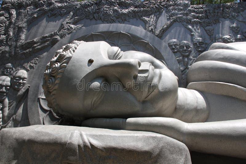 Detail of the smiling reclining Buddha statue at Long Son Pagoda, Nha Trang, Vietnam royalty free stock photography