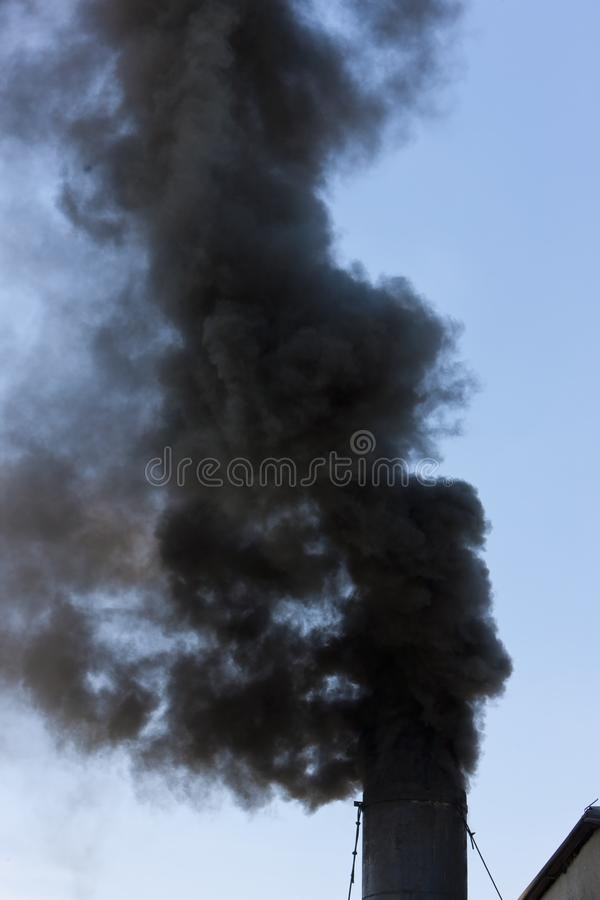 Detail of smoking chimney. Outdoors, outside, exteriors, industry, industrial, smoke, dirt, dirty, pollution, environment, ecology royalty free stock image