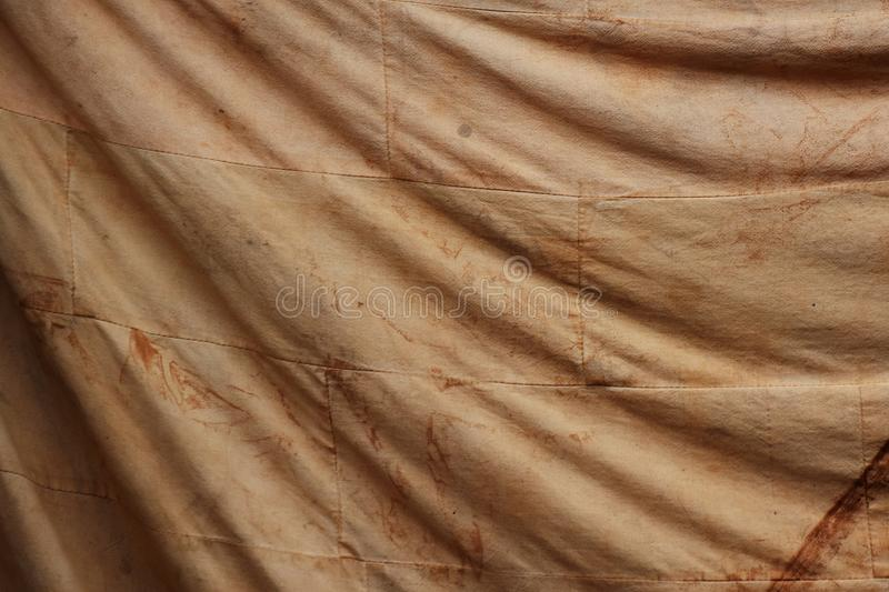 Smudge on old brown cloth for background. Detail smudge on old brown cloth for background royalty free stock image