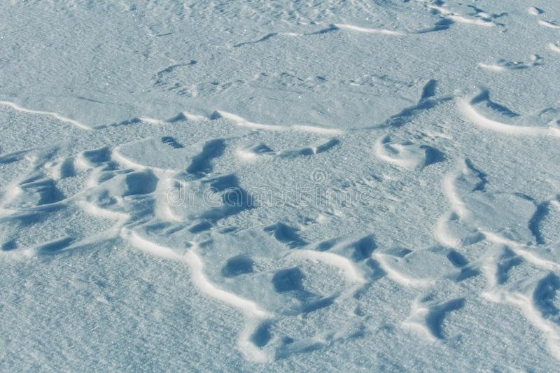 Detail of snow and freeze texture formed by wind stock image