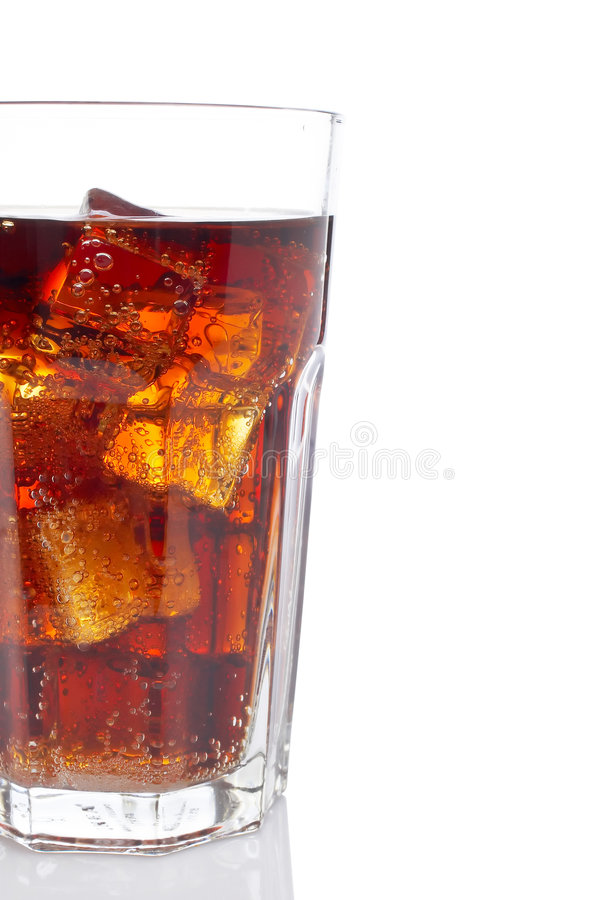 Detail of soda with ice cubes. Glass, reflected on white background stock image