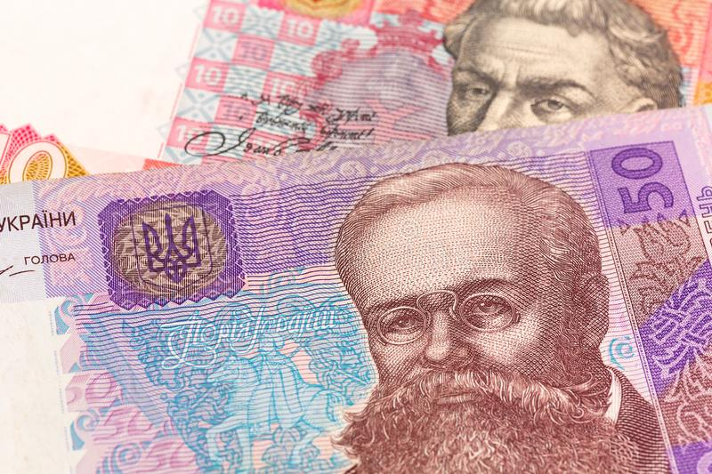 Detail of some ukrainian hryvnia banknotes indicating growing economics. Detail of some new ukrainian hryvnia banknotes indicating growing economics stock images