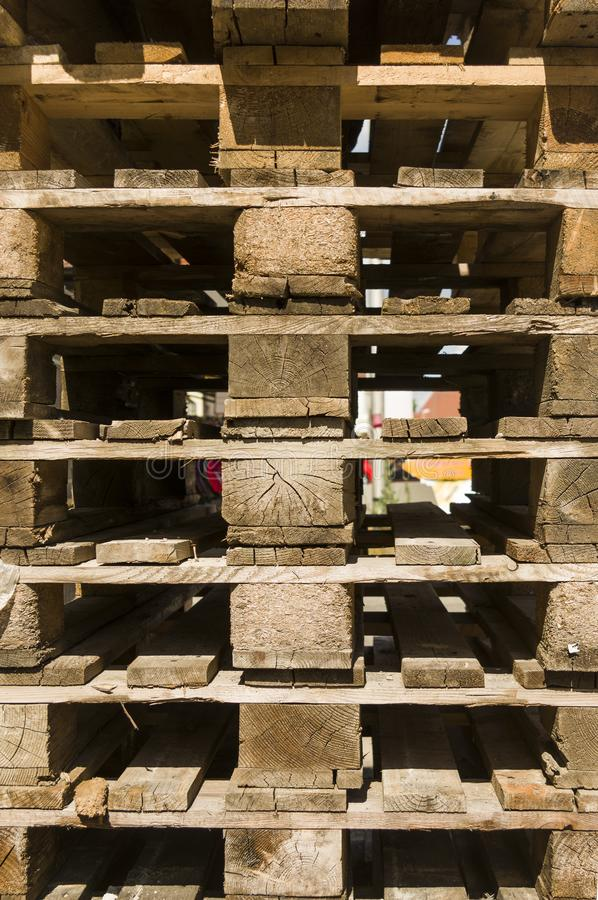 Detail of a stack of empty returnable wooden pallets in Euronorm stock photo