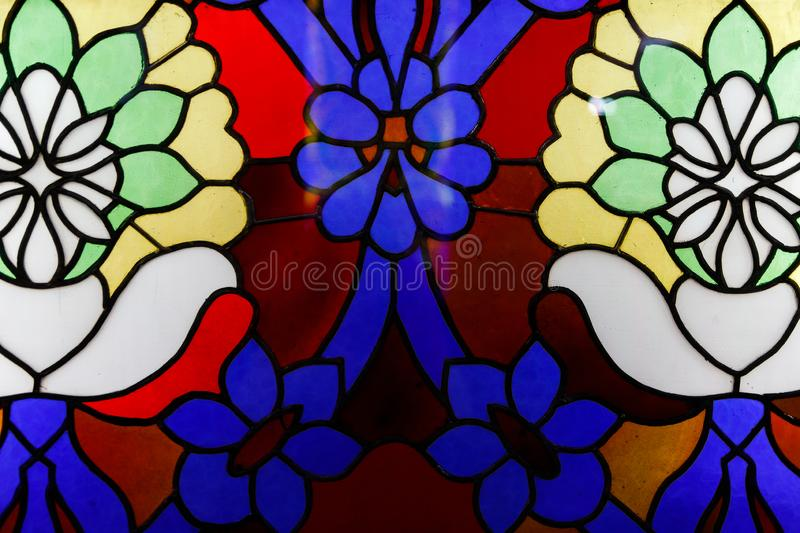 Detail of a stained glass window. Bright colors, shot close-up stock photography