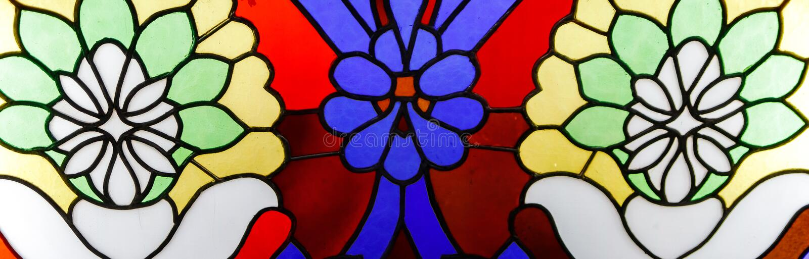 Detail of a stained glass window. Bright colors, shot close-up royalty free stock images