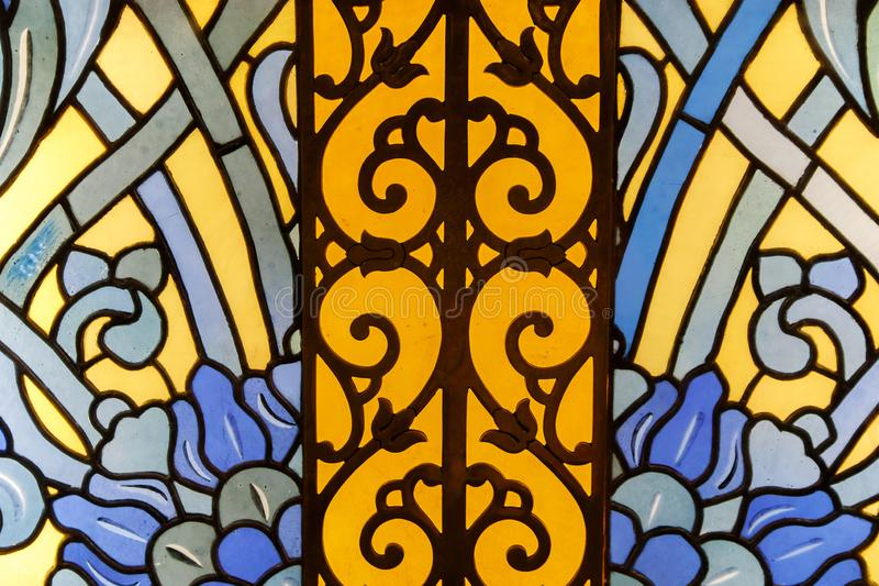 Detail of a stained glass window. Bright colors, shot close-up royalty free stock photography
