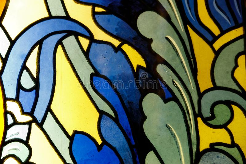 Detail of a stained glass window. Bright colors, shot close-up royalty free stock photo