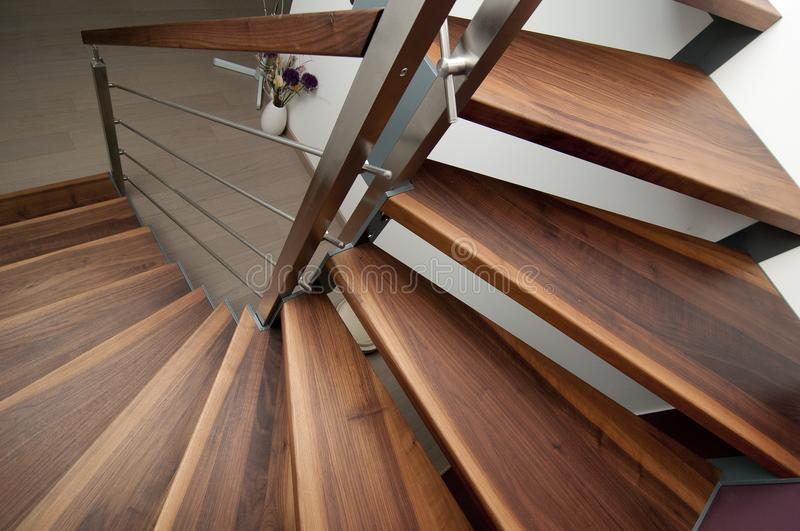 Detail of staircase. Which is made from wood and steel royalty free stock image