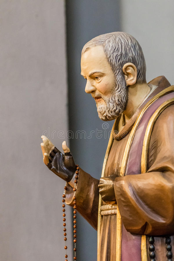detail of a statue of Saint Father Pius stock photography