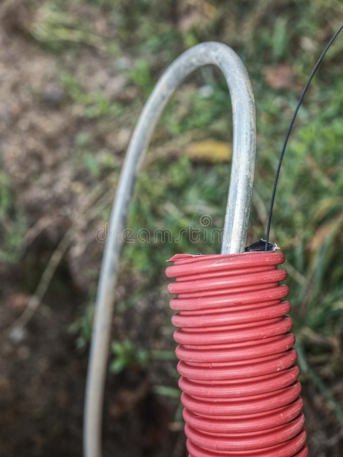 Steel earthing wire in ribbed flexible and plastic tube royalty free stock photography