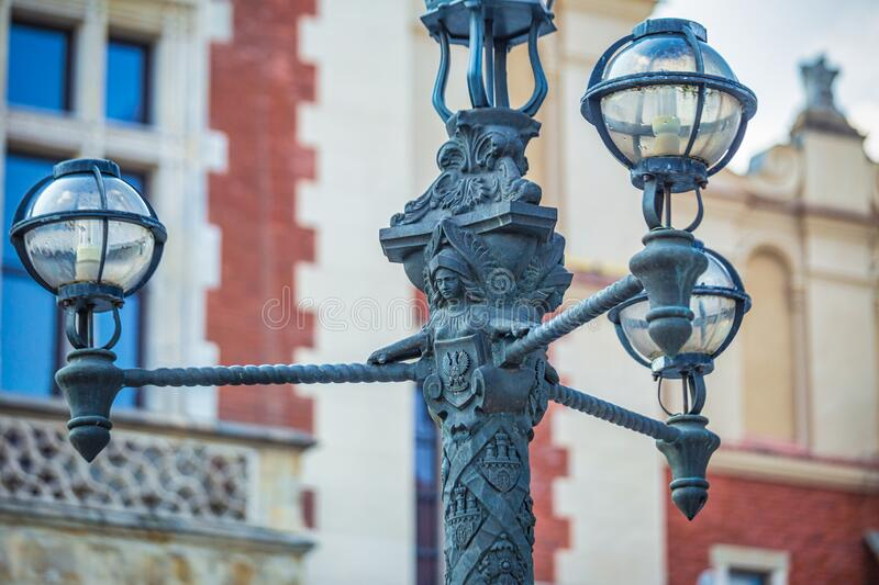 Detail of a street lamp in the historic center of Krakow royalty free stock photography