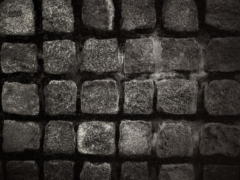 Stone cube as a solid backdrop - background. Detail from the street - stone cube as a solid backdrop - wallpaper - black and white stock photos