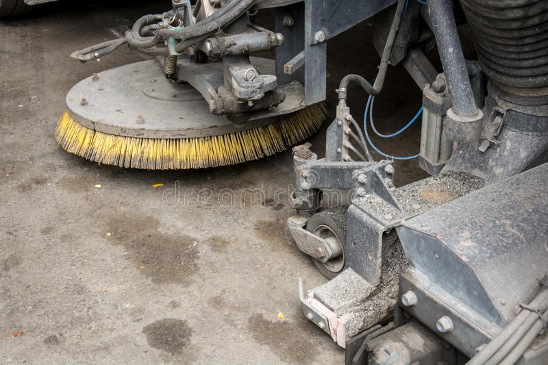 Detail of a street sweeper machine car cleaning royalty free stock photography