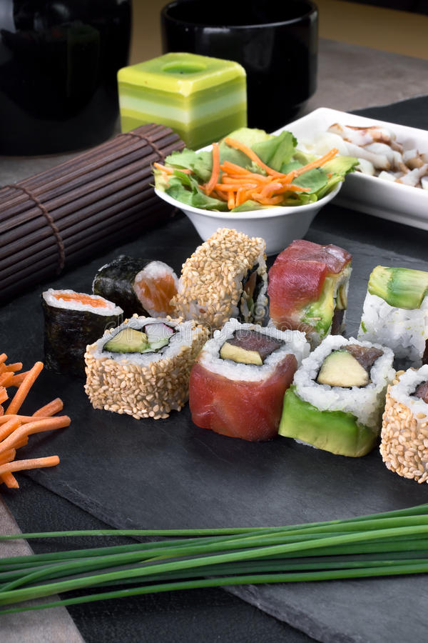 Detail sushi rolls prepared on plate royalty free stock photo
