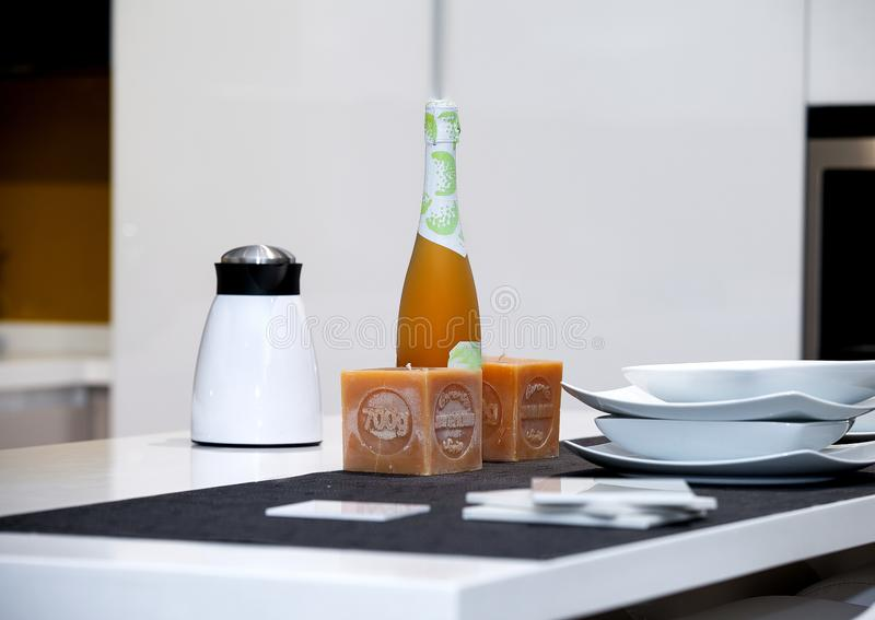 Detail of a table with siphon, coffee machine, bottle of wine 4. Detail of a modern table in a home kitchen with siphon, coffee machine, bottle of wine, two stock photography