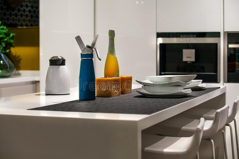 Detail of a table with siphon, coffee machine, bottle of wine. Detail of a modern table in a home kitchen with siphon, coffee machine, bottle of wine, two stock photos