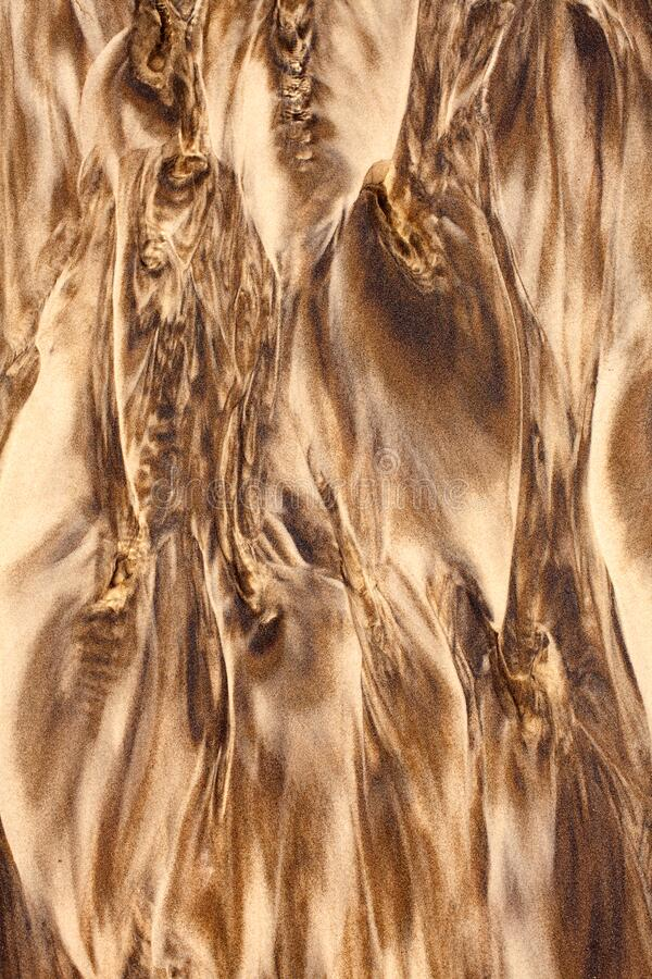 Detail of textural patterns in sand. As the water runs across the beach royalty free stock image